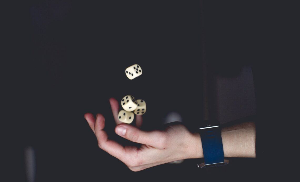 Man hand with Dices